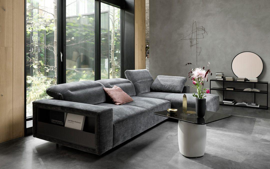 Hampton sofa with adjustable headrests and integrated armrest storage