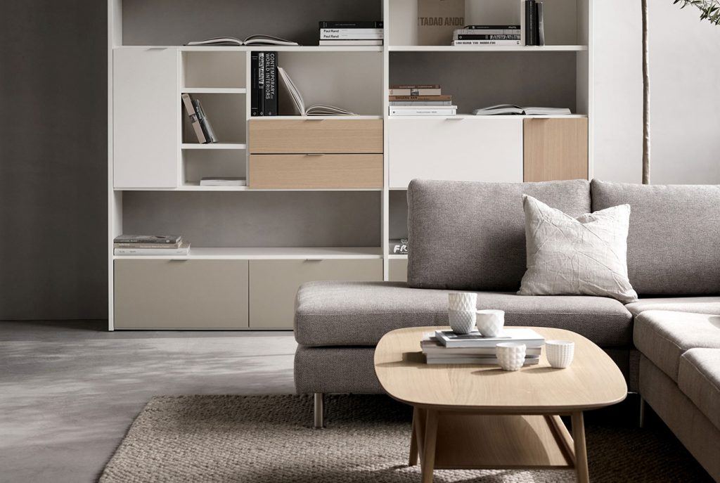 Grey sofa with wooden coffee table and shelves