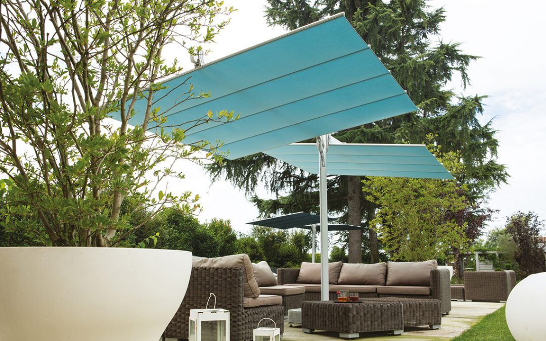 Twin umbrella systems to shade large areas