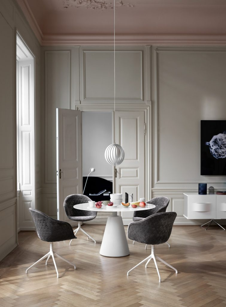 Madrid dining table and Adelaide chairs in quilted velvet by BoConcept